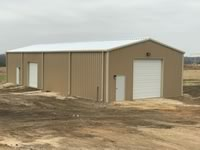 30' x 80' x 14' metal tractor shed with tall roll up door