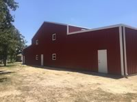 80' x 125' x 14' red metal barn with 25' lean too