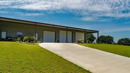 Custom built metal barndominium built with drive way added