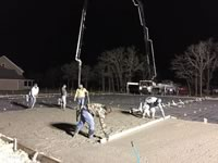 Early morning concrete pour for the construction of a large Metal Building