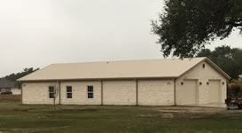 Custom built barndominum with 2 garage doors on the end