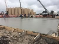 Concrete foundation pour using a pump truck at an industrial facility location