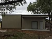 Custom built metal building with a lean to