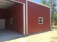 Lean to metal cattle and ranch feed room