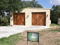 2 Car metal building garage with custom wood doors
